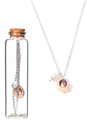 www.sayila.nl - Halsketting met schelp in glazen flesje