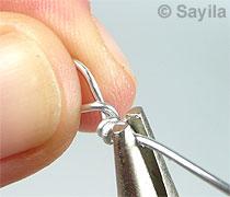 Vollenden einer Halskette mit Hilfe einer Schlaufe 4