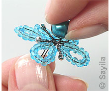 Create a flower from copper wire and seed beads
